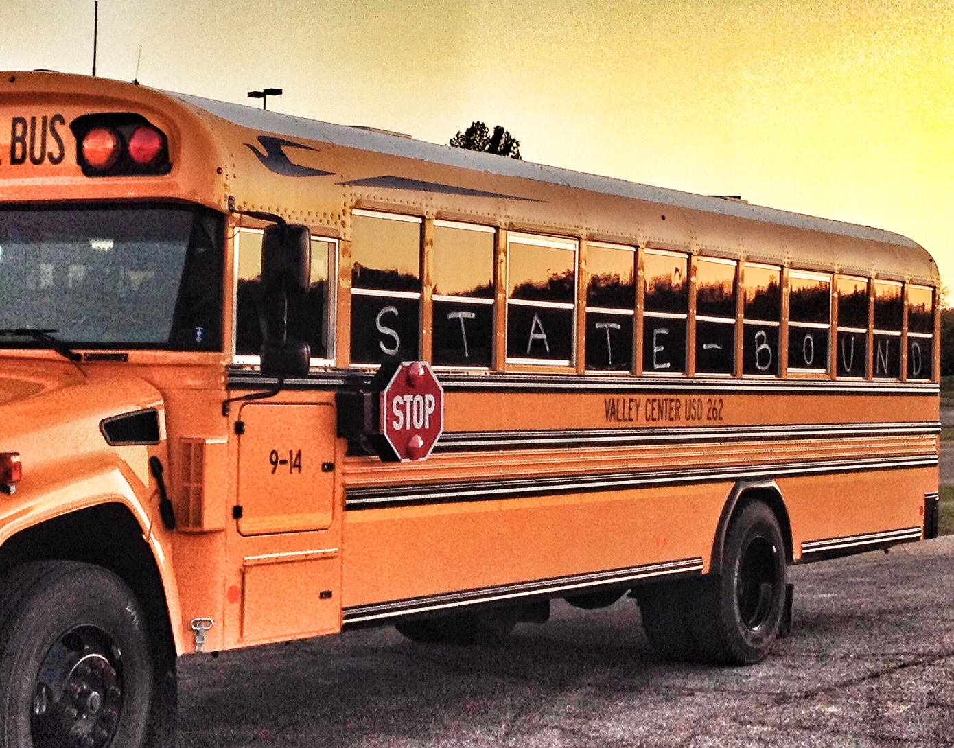 This is a typical Kansas school bus; this one carried the Valley Center volleyball team to the state tournament in Topeka in 2014.  It's simply used here for illustrative purposes, to represent education. (Photo by J. Schafer)