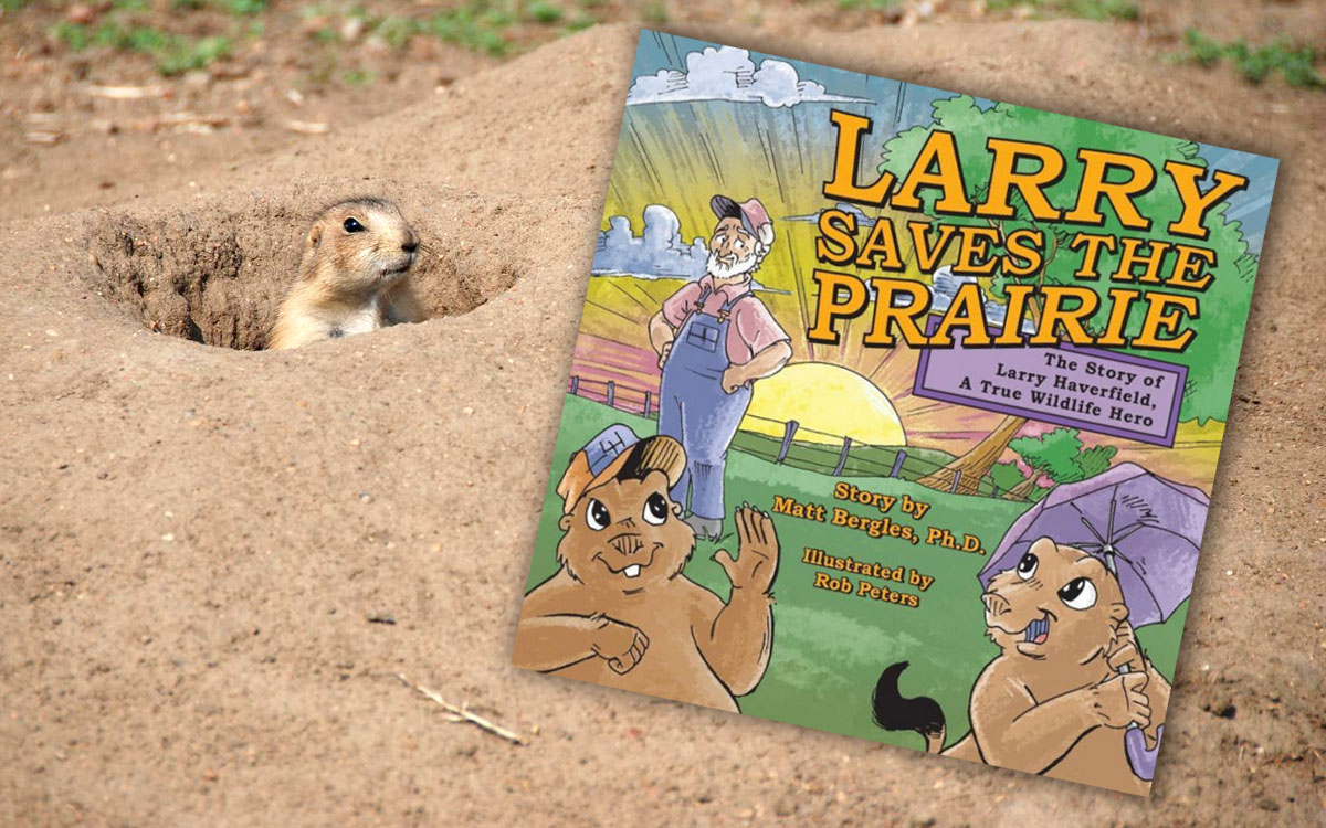 "A Kansas prairie dog looks upon the children's book, ""Larry Saves the Prairie."" (Flickr Photo by Randy Watson)"