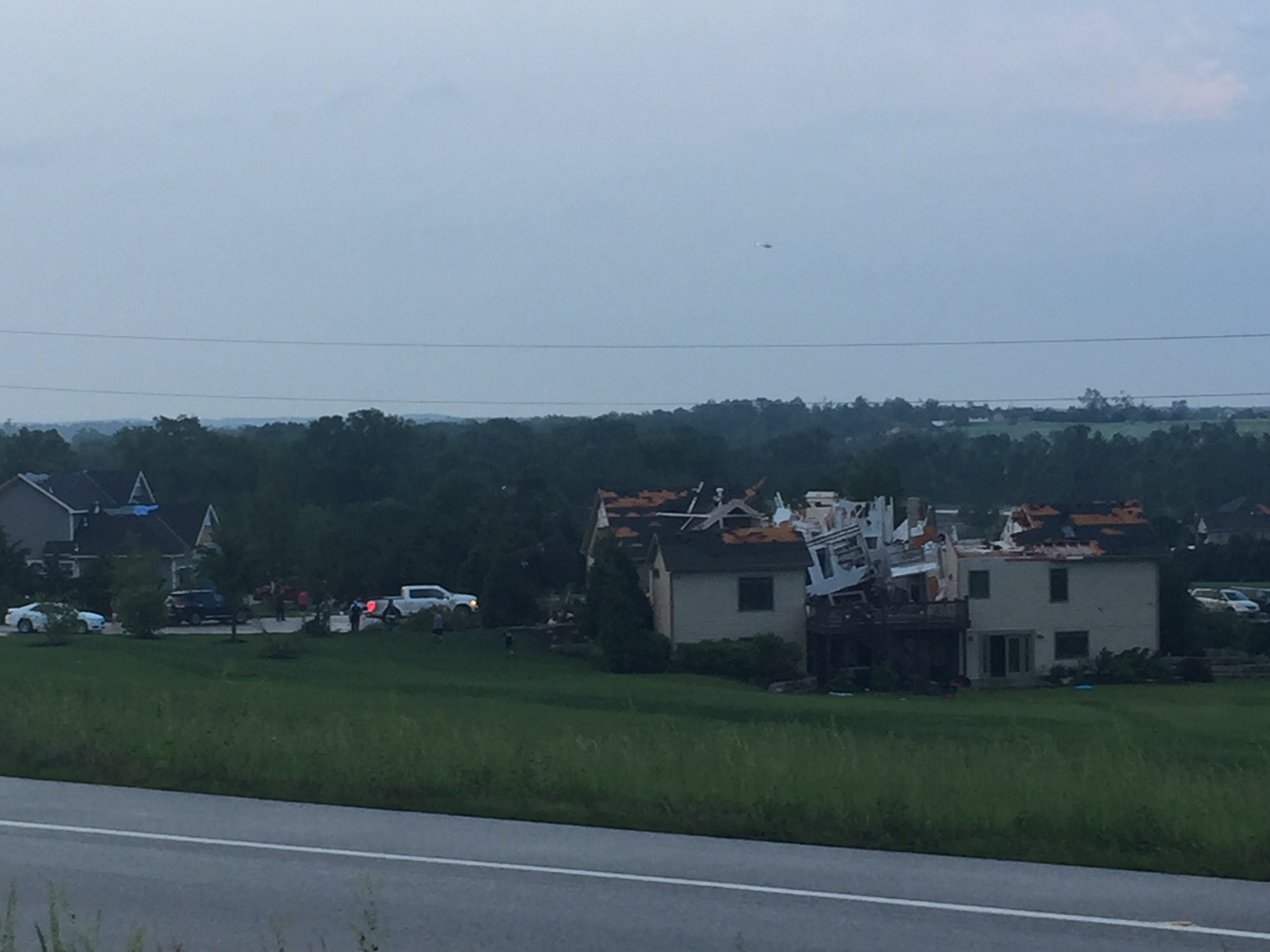 Damaged and destroyed homes, along U.S. Highway 59, south of Lawrence (Photo by J. Schafer)