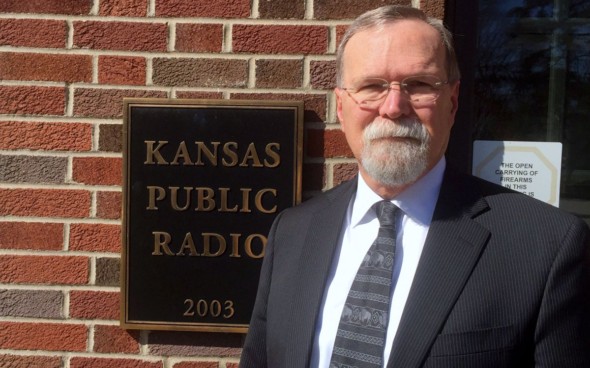 Kansas Supreme Court Chief Justice Lawton Nuss standing outside of Kansas Public Radio in Lawrence. (File photo by J. Schafer)