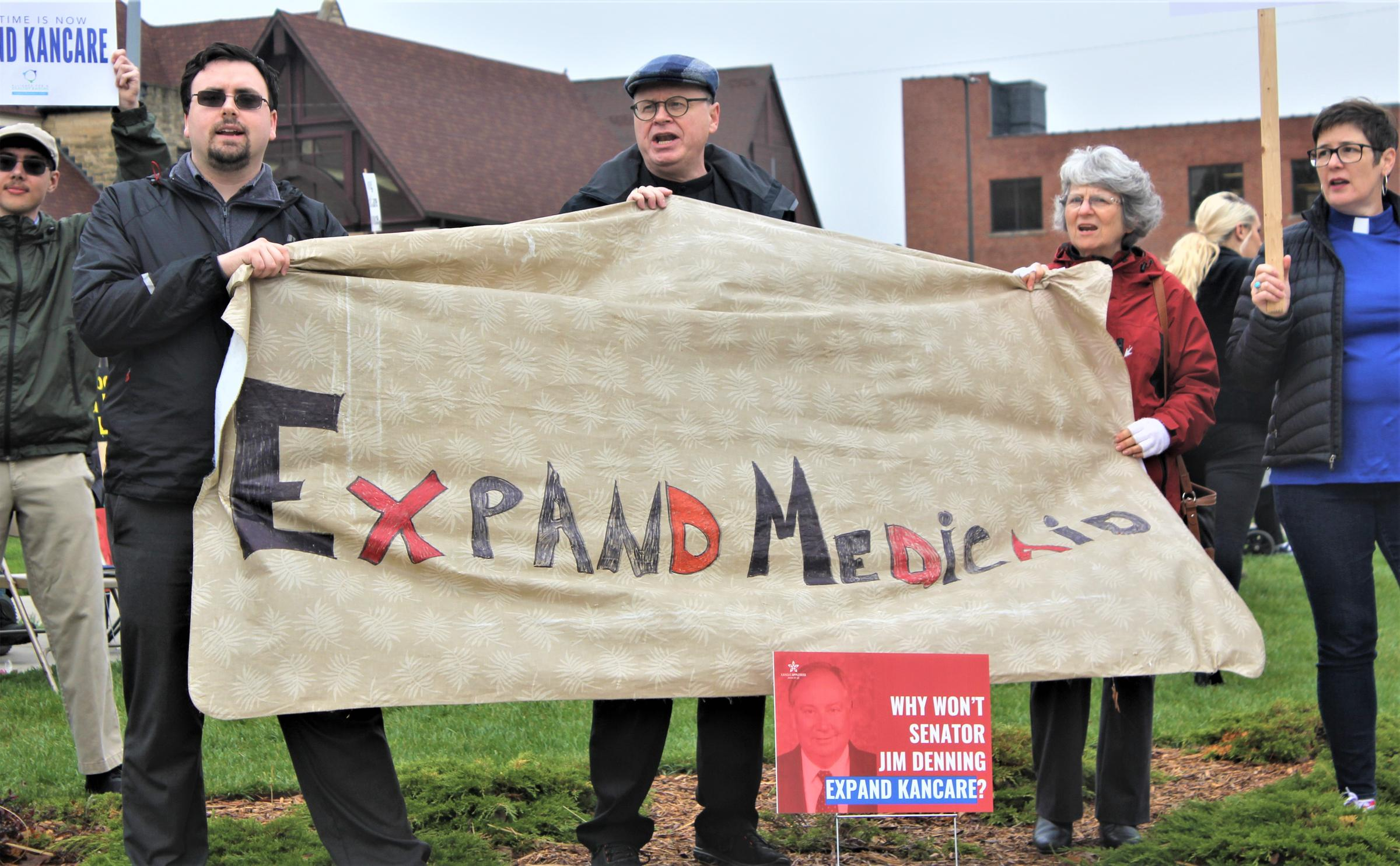 Protesters last year targeted Senate Majority Leader Jim Denning for blocking Medicaid expansion. Now he and Gov. Laura Kelly have settled on a compromise. (Photo by Jim McLean, Kansas News Service)