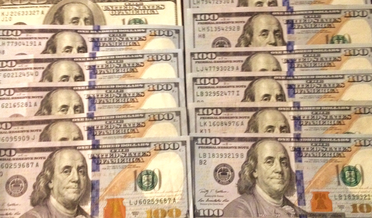 U.S. currency in the form of $100 bills  (Photo by J. Schafer)