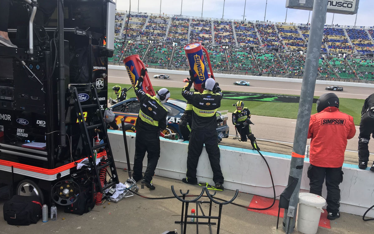 Emporia native Chris Tidwell (holding the gas can on the left) served on the crew of Ryan Blaney during the fall 2019 Cup race at Kansas Speedway. (Photo by Greg Echlin)