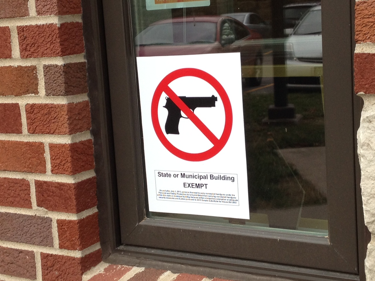 "One of the hundreds of ""No Gun"" signs posted on the campus of the University of Kansas in Lawrence; this one hangs outside Kansas Public Radio (Photo by J. Schafer)"