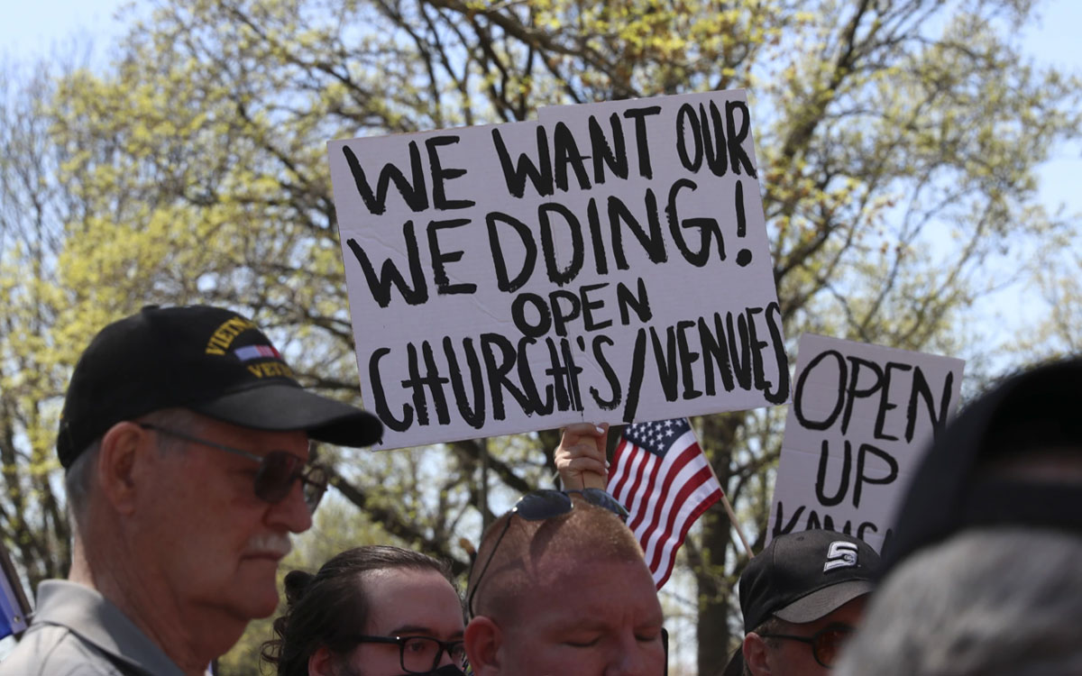 In April, protesters outside the Kansas Statehouse demanded that Governor Laura Kelly let businesses and activities return to normal. (Photo by Nomin Ujiyediin, Kansas News Service)