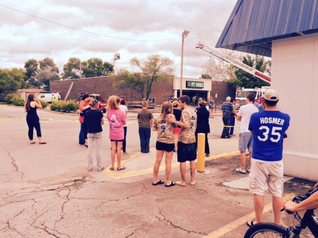 Anxious onlookers at the scene of the Pet World fire in Lawrence, May 25, 2015 (Image credit: Richard Noggle)