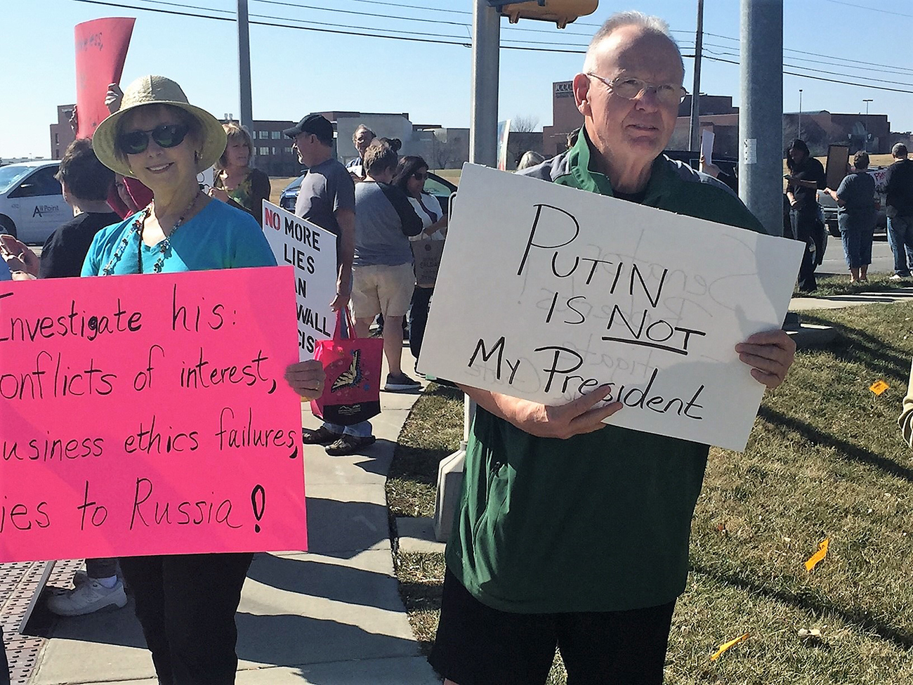 Protesters gather in Overland Park (Photo by Jim McLean)