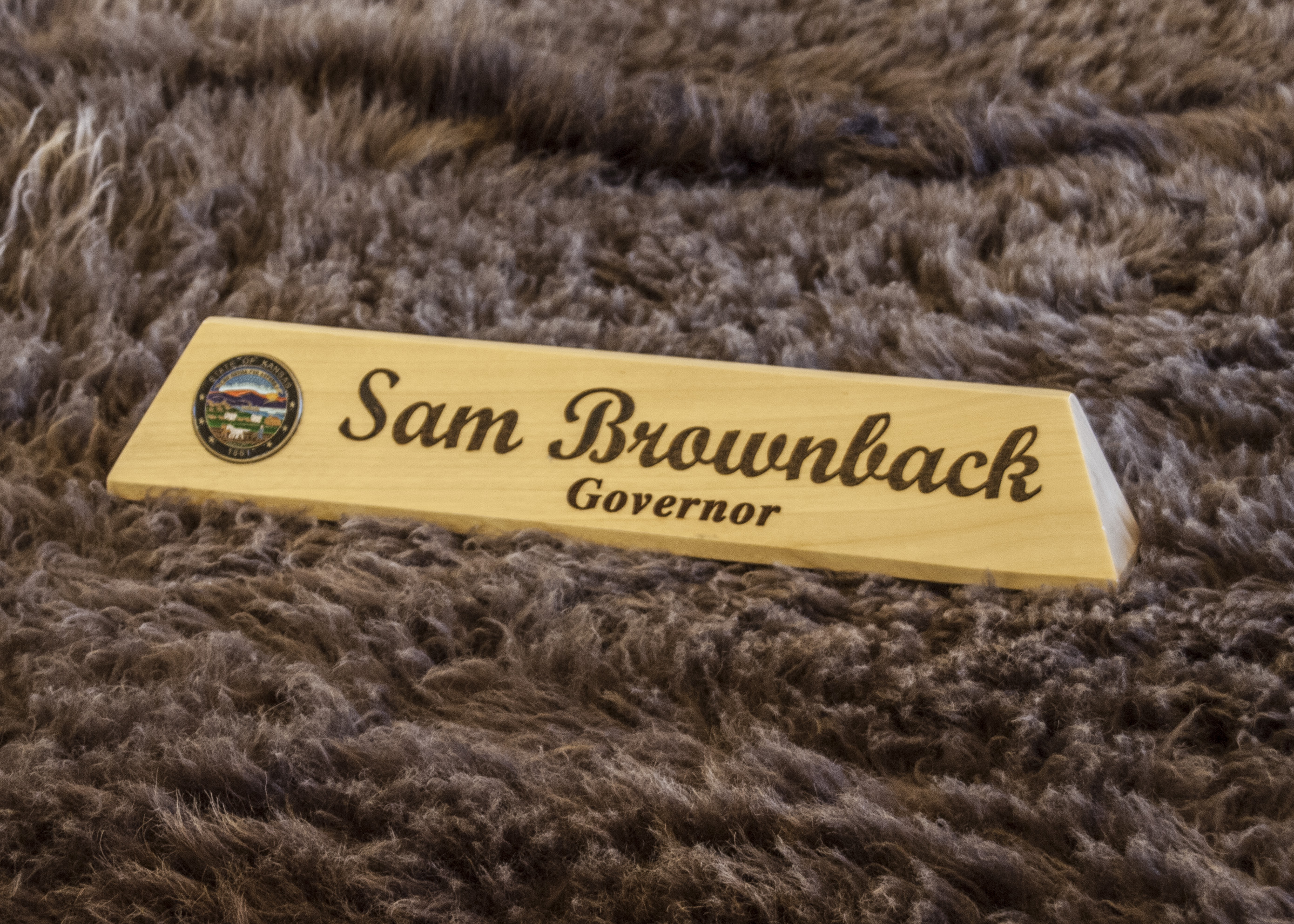 Name plate inside Governor Sam Brownback's office at the Kansas Statehouse.  (Photo by Dan Skinner)