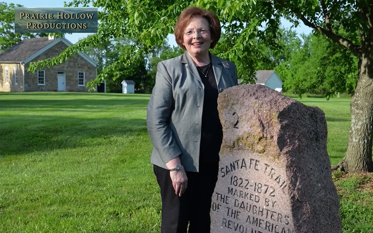 Overland Park resident Pat Traffas, with the Kansas Society of the Daughters of the American Revolution, stands next to a DAR marker near Lanesfield School in Johnson County.