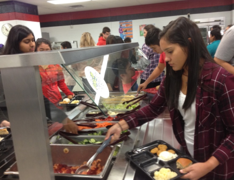 Students at Liberal High School are allowed to take as much fruit and vegetables as they'd like from the school's salad bar. (Photo: Bryan Thompson)