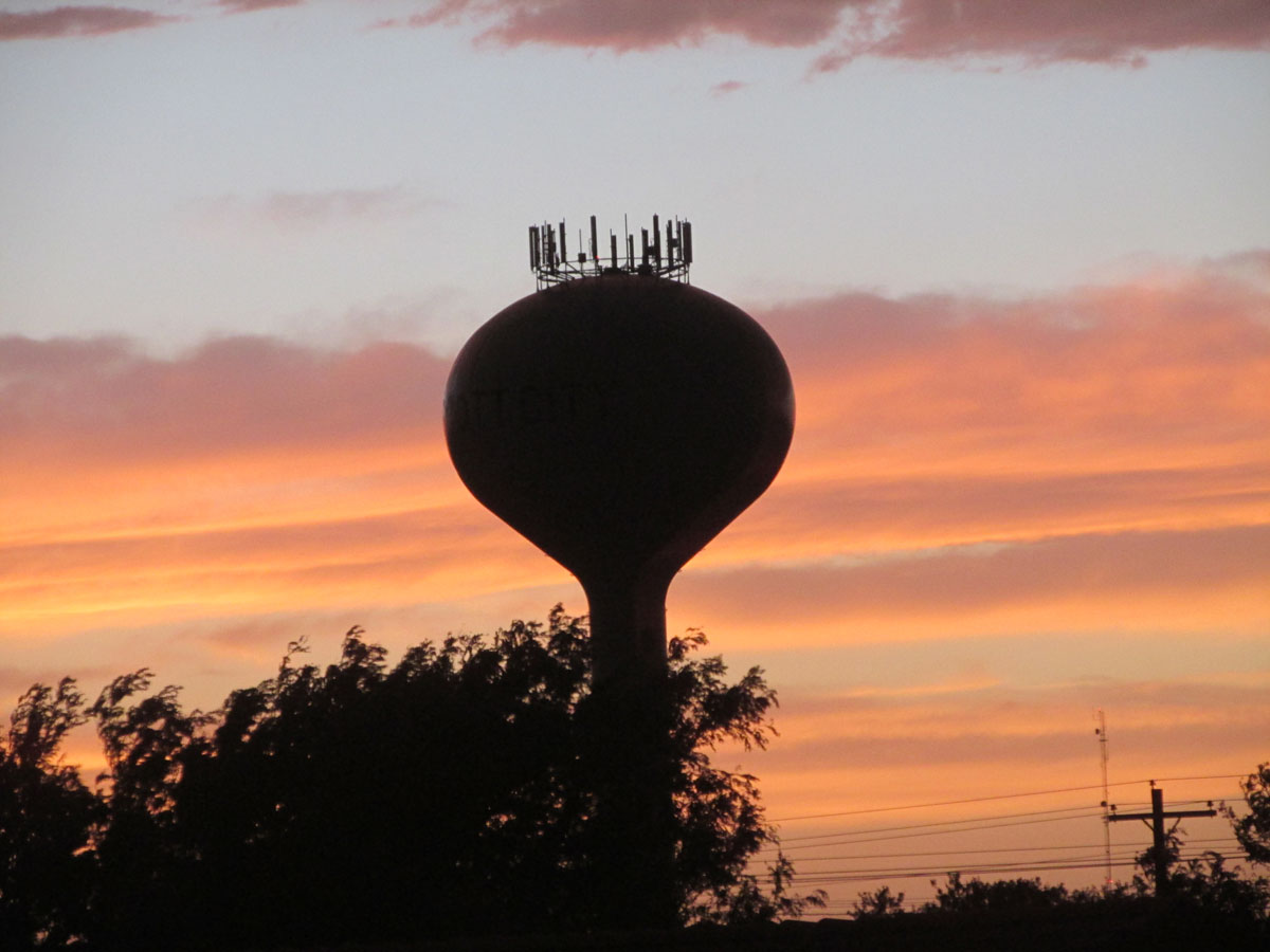 A summer sunset silhouette of the Scott City, Kan., water tower. (Photo by David Guth)