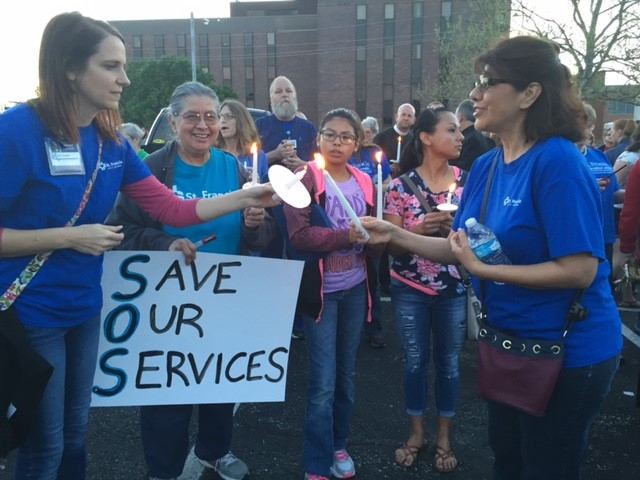 Several hundred people turned out Monday night to protest the possible closure of St. Francis Health in Topeka. (Photo: Kansas News Service)