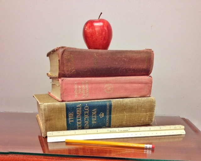 Teacher's apple on a stack of books (Photo by J. Schafer)