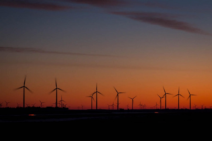Wind turbines dot the landscape near I-70 in Ellsworth County. (Photo Credit: Brian Grimmett)
