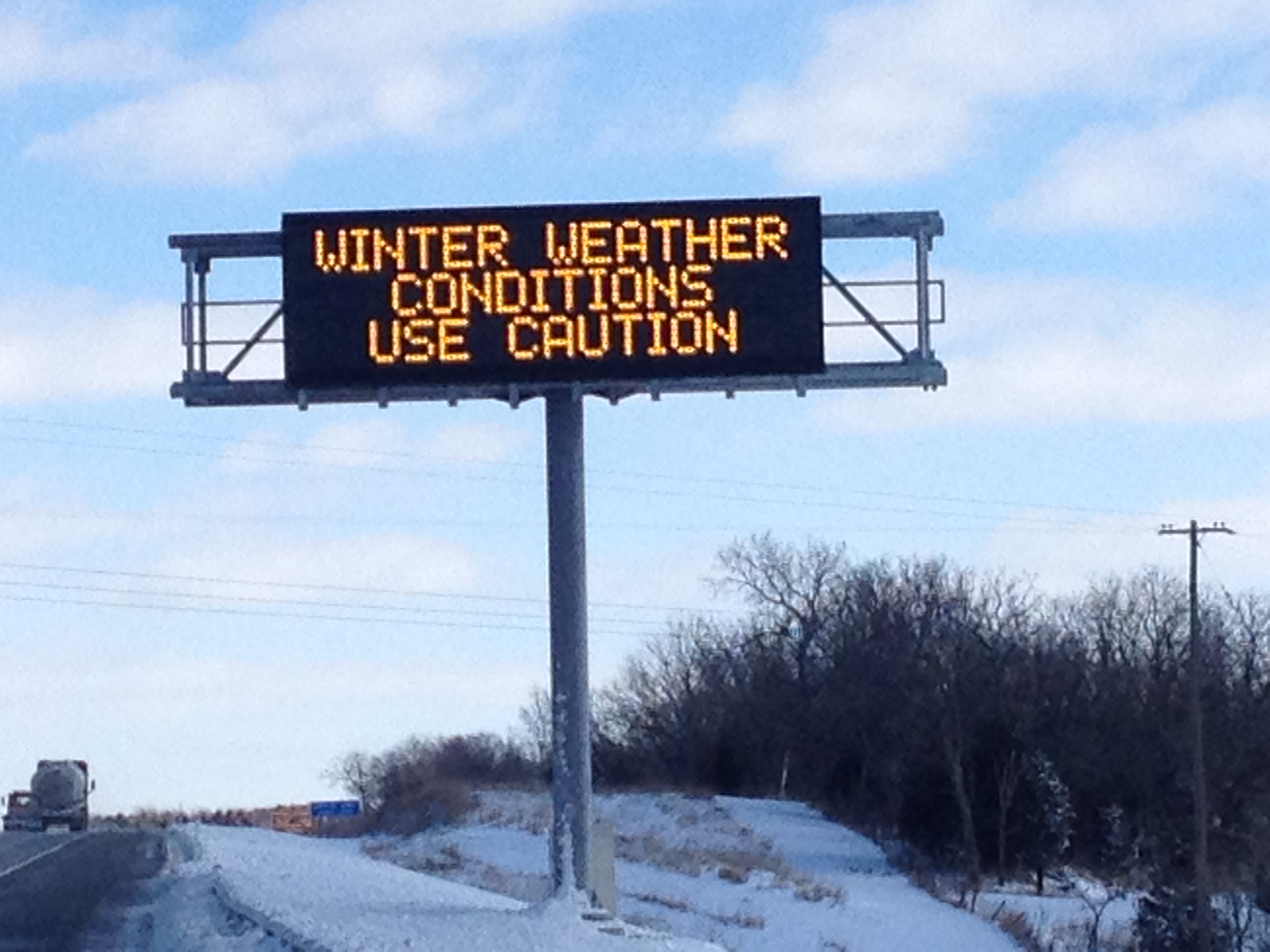 Winter weather messages flash on a sign along Interstate 70 (file photo by J. Schafer)