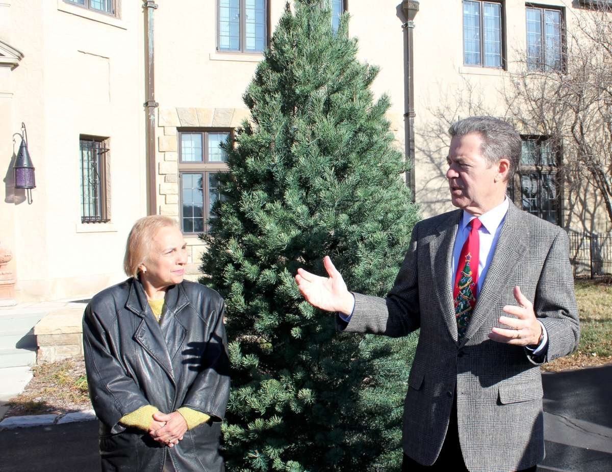 Celia Goering and Governor Sam Brownback with the official Christmas tree for the governor's mansion. (Photo by Stephen Koranda)