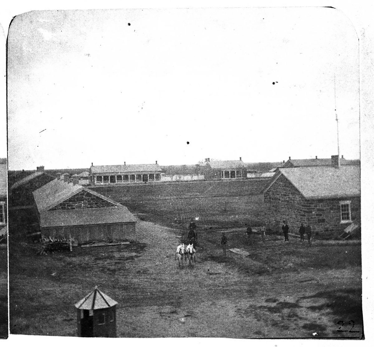 View of block house and parade ground of early Fort Larned. Date: 1860-1878 (Photo via Kansas Historical Society / kansasmemory.org)