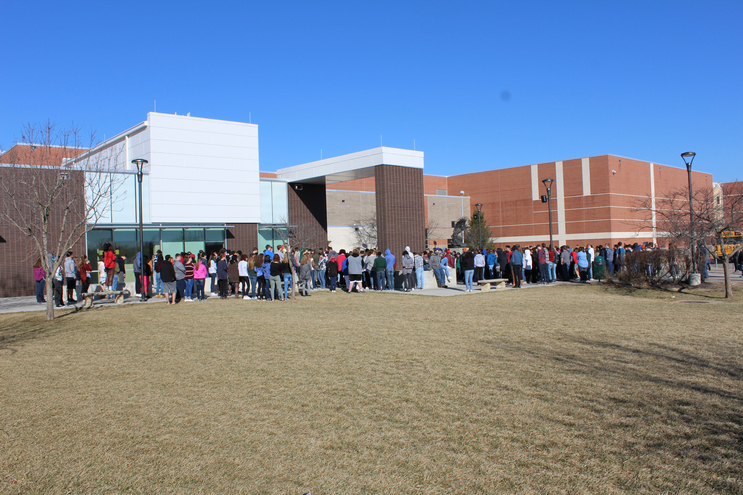 Students at Free State High School in Lawrence walked out of class Wednesday morning as part of a nationwide protest against gun violence. (Photo by J. Schafer)