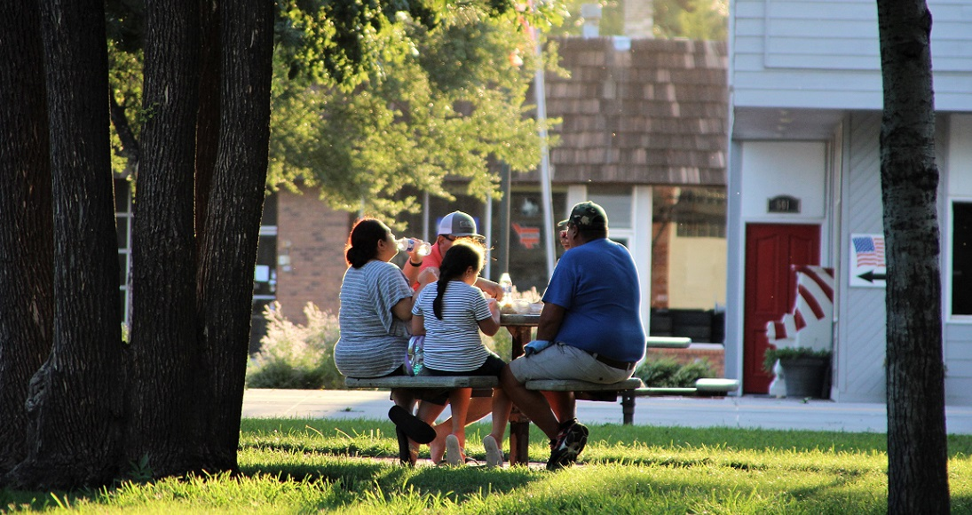 A family in a Garden City park. (Photo by Corinne Boyer / Kansas News Service)
