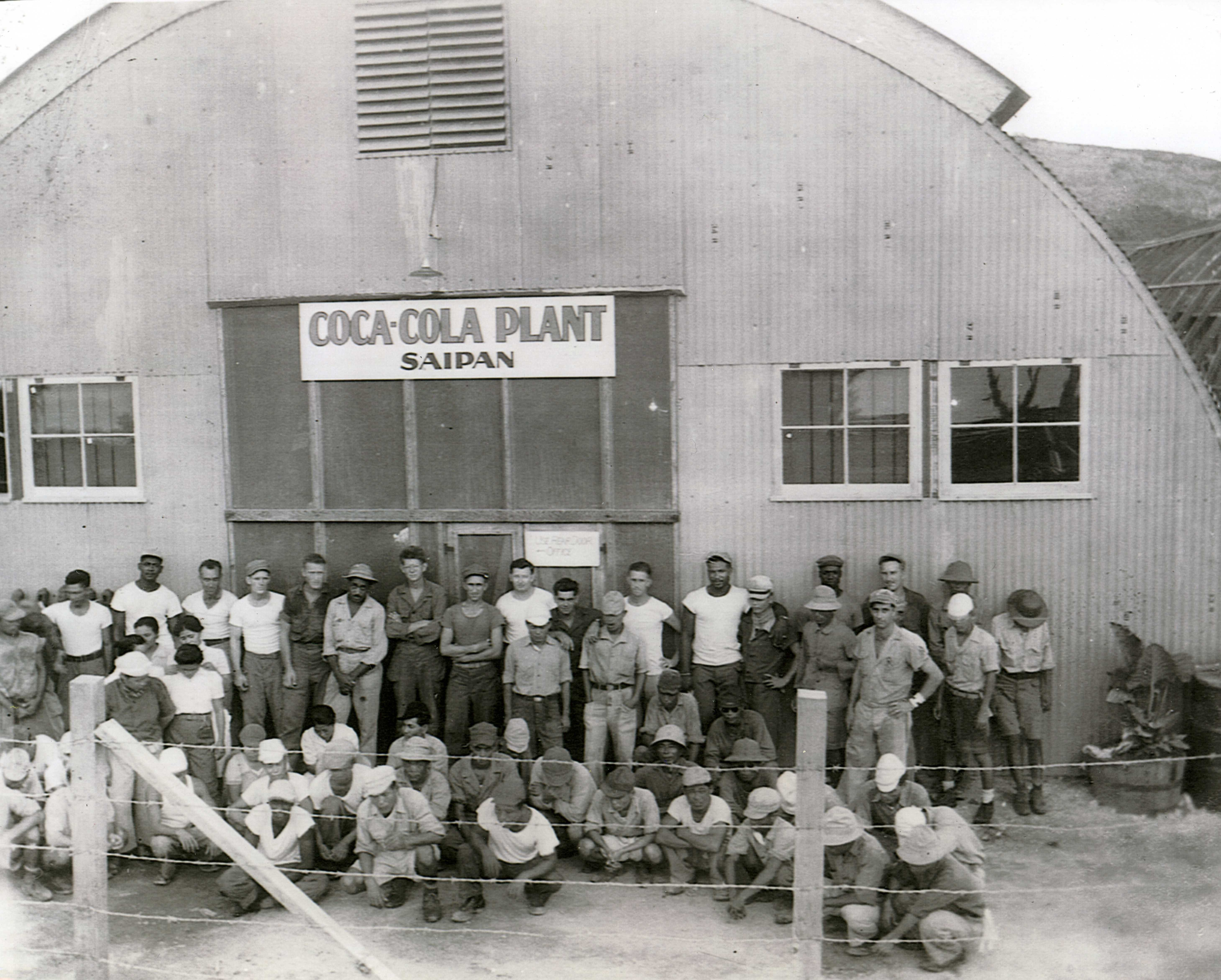 The staff of the Coca-Cola bottling plant established on Saipan. (Photo via The National WWII Museum Inc)