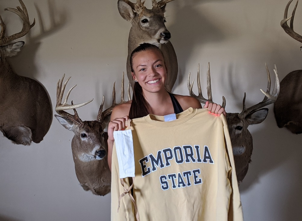 Ehlaina Hartman shows off some school spirit -- she's planning to attend Emporia State University and play for their women's basketball team. (Photo by Stephan Bisaha / Kansas News Service)
