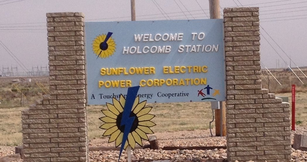A welcome sign greets visitors at the existing coal-fired power plant in Holcomb.  (Photo by Bryan Thompson)