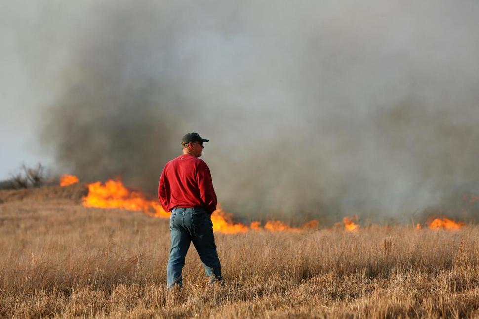 A wildfire burns in Hutchinson on Sunday.  Fire crews in south-central, southwest and northwest Kansas have been working to control numerous grass since the weekend. (Lindsey Bauman / The Hutchinson News via AP) The Associated Press