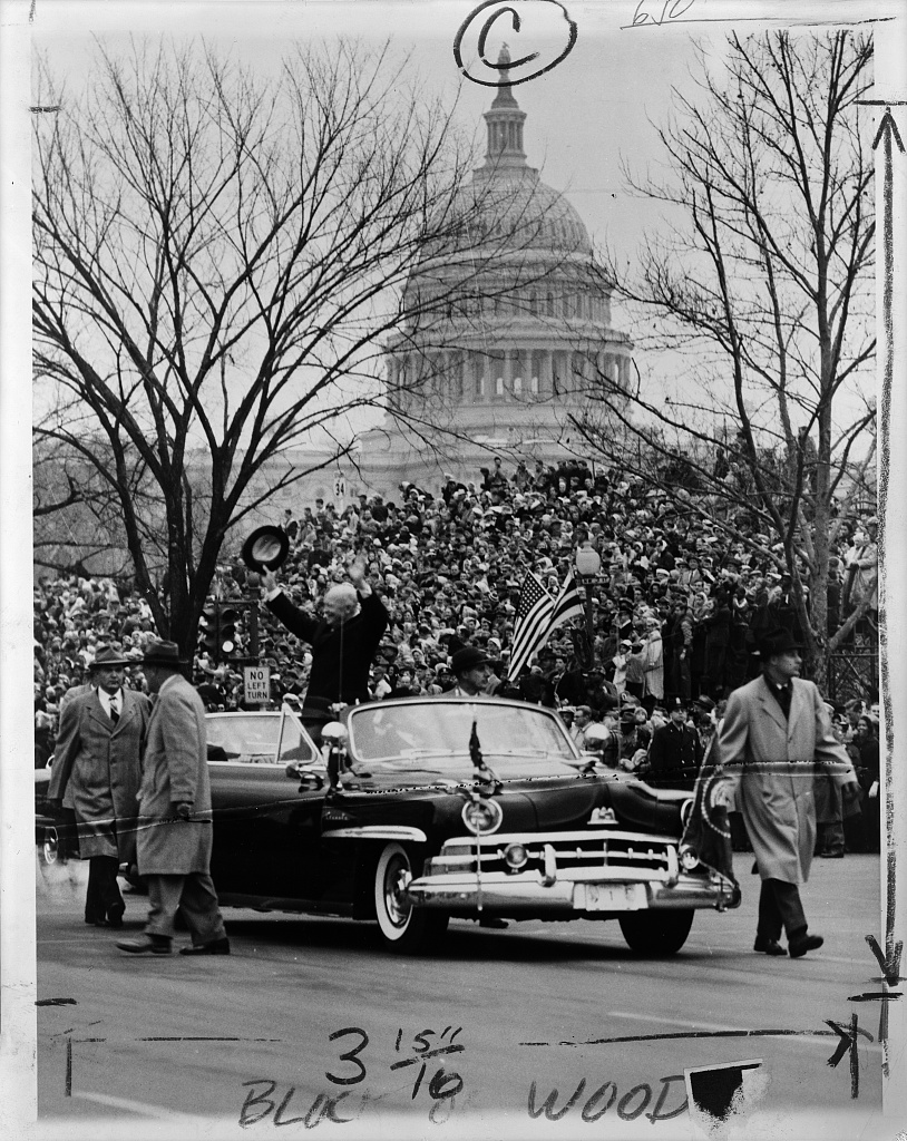 Ike waves to parade crowds, January 22, 1957. (Photo via Library of Congress)