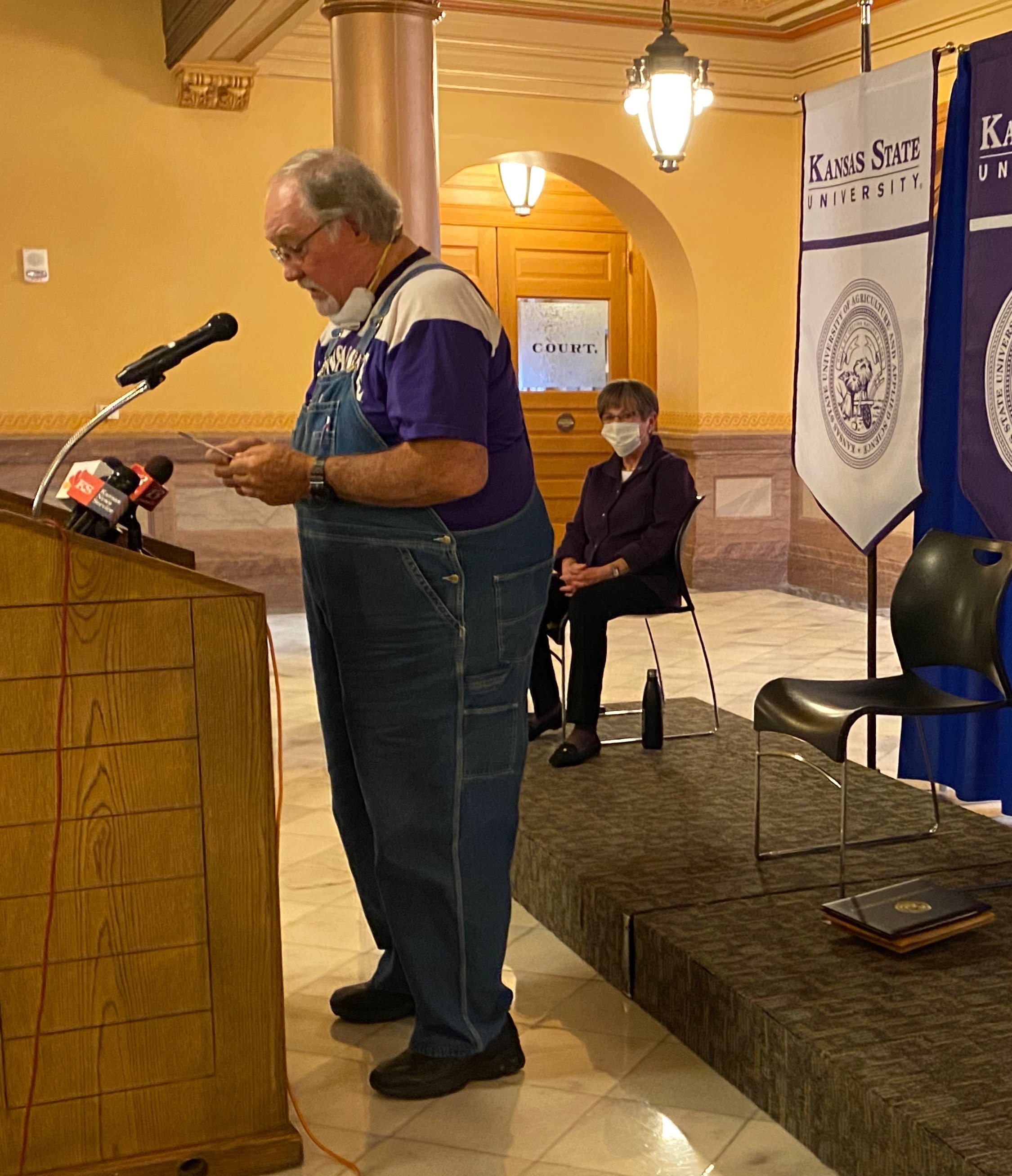 Retired Kansas farmer Dennis Ruhnke, of Troy, accepting a degree from K-State President Richard Myers and Governor Laura Kelly.  Ruhnke was just a couple credits shy of earning his bachelor's degree from K-State in 1971 when his father died and Ruhnke left school to care for his mother and the family farm.  (Photo from governor's office.)