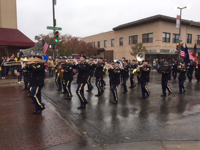 A military band marched down Mass Street, as seen here at the intersection of 9th and Mass.