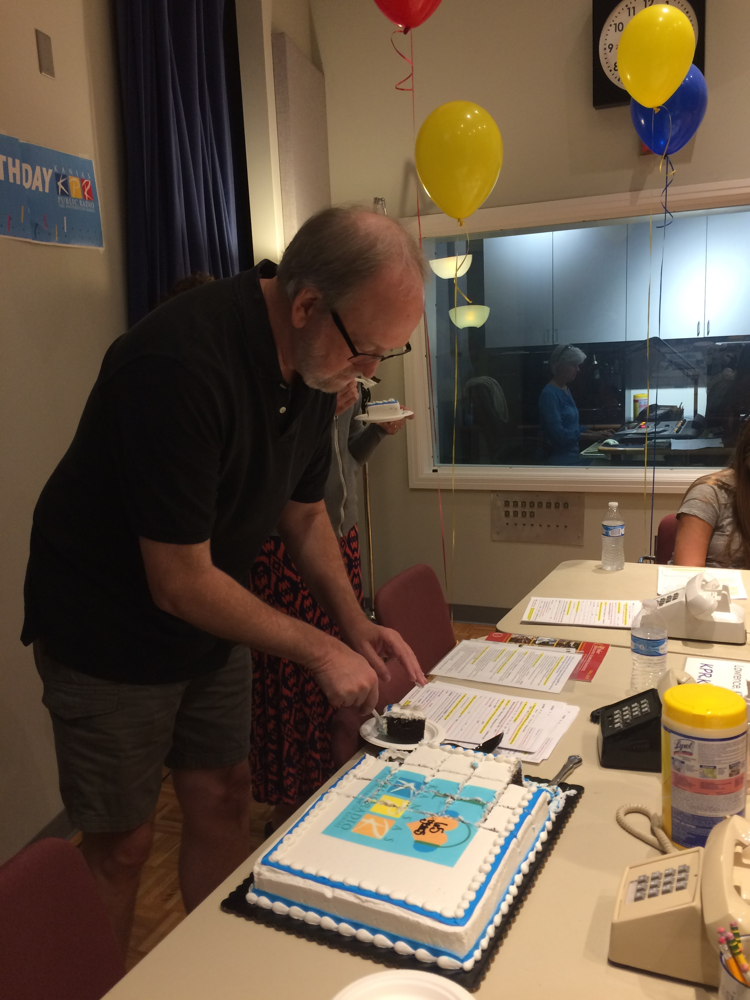 KPR's Program Director, Darrell Brogdon, dishes out the 65th birthday cake celebrating the end of the membership drive.