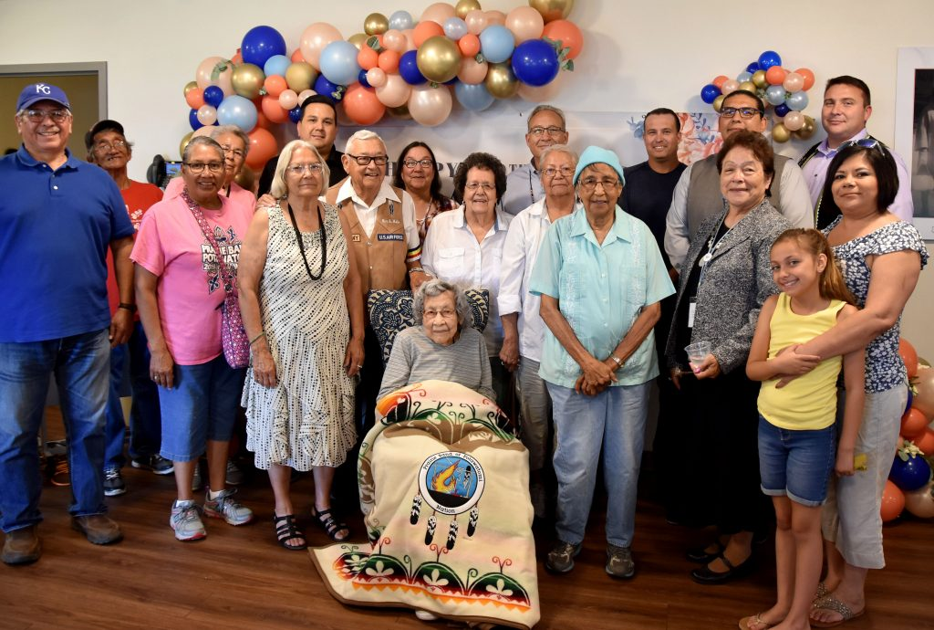 Prairie Band Potawatomi Nation Tribal Council and elders surround Julia Kabance at her birthday celebration in Wamego. (Photo from the Potawatomi Nation)