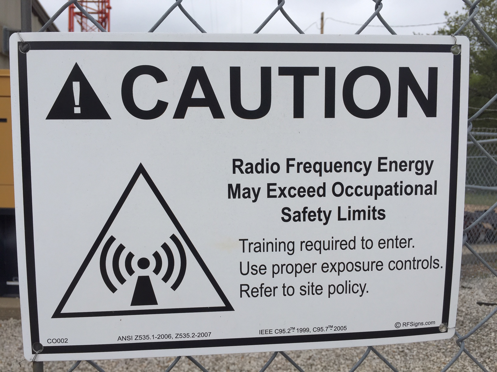 Signage near the KANU FM transmitter tower on the KU campus. (Photo by J. Schafer)