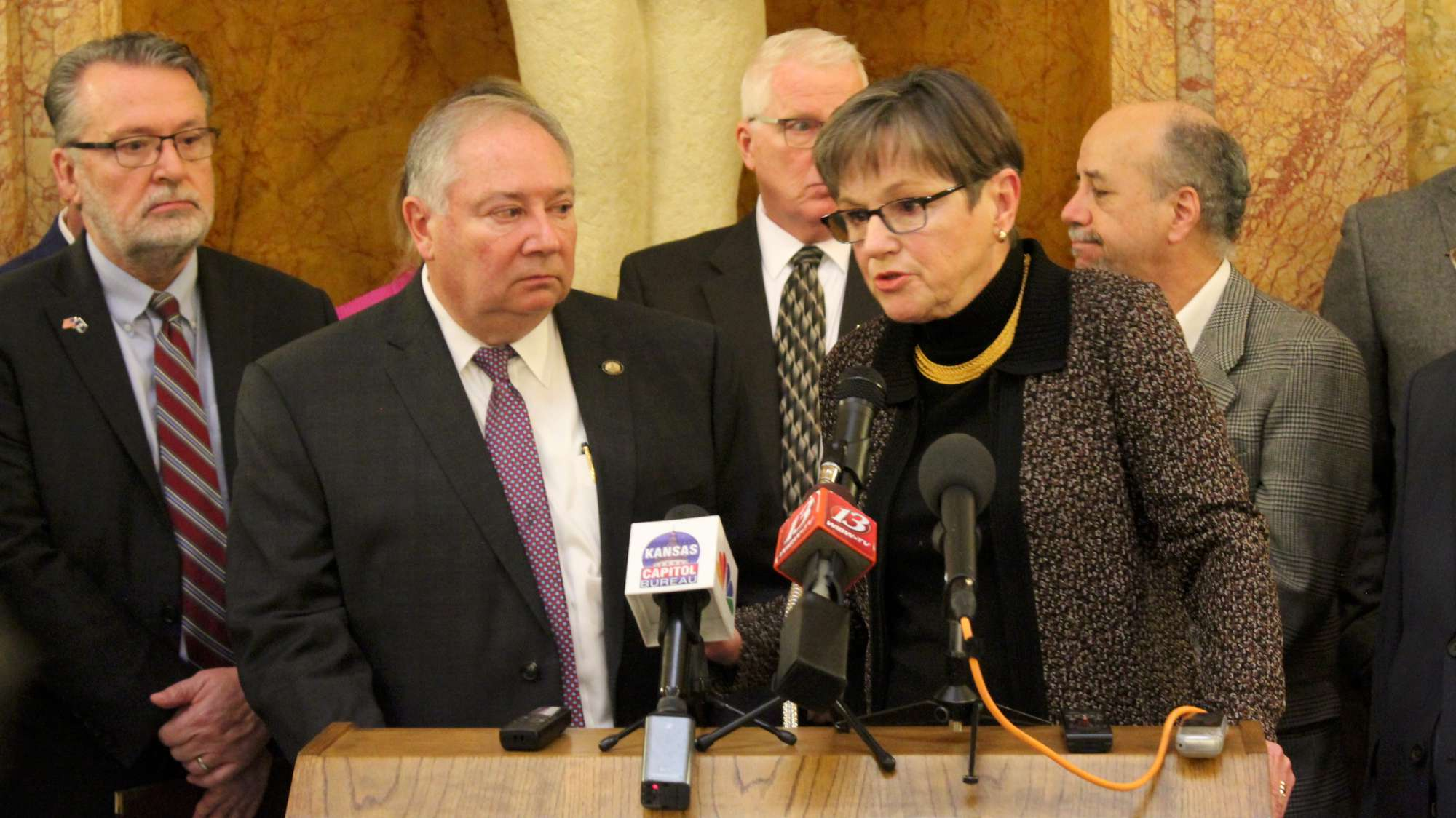 Gov. Laura Kelly and Senate Majority Leader Jim Denning announcing a Medicaid expansion compromise on Thursday. (Photo by Stephen Koranda)