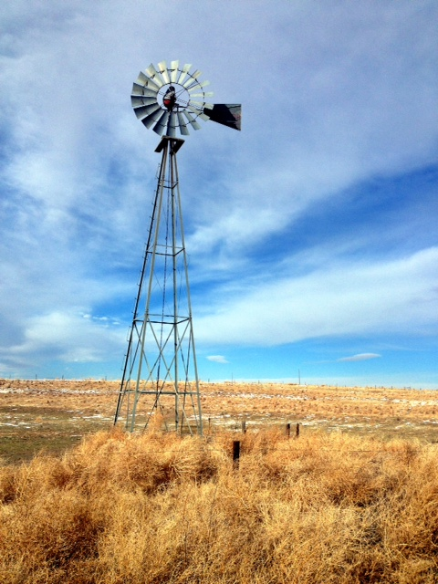 A traditional (old school) windmill stands guard in a cold pasture near St. Francis. (Photo by J. Schafer)