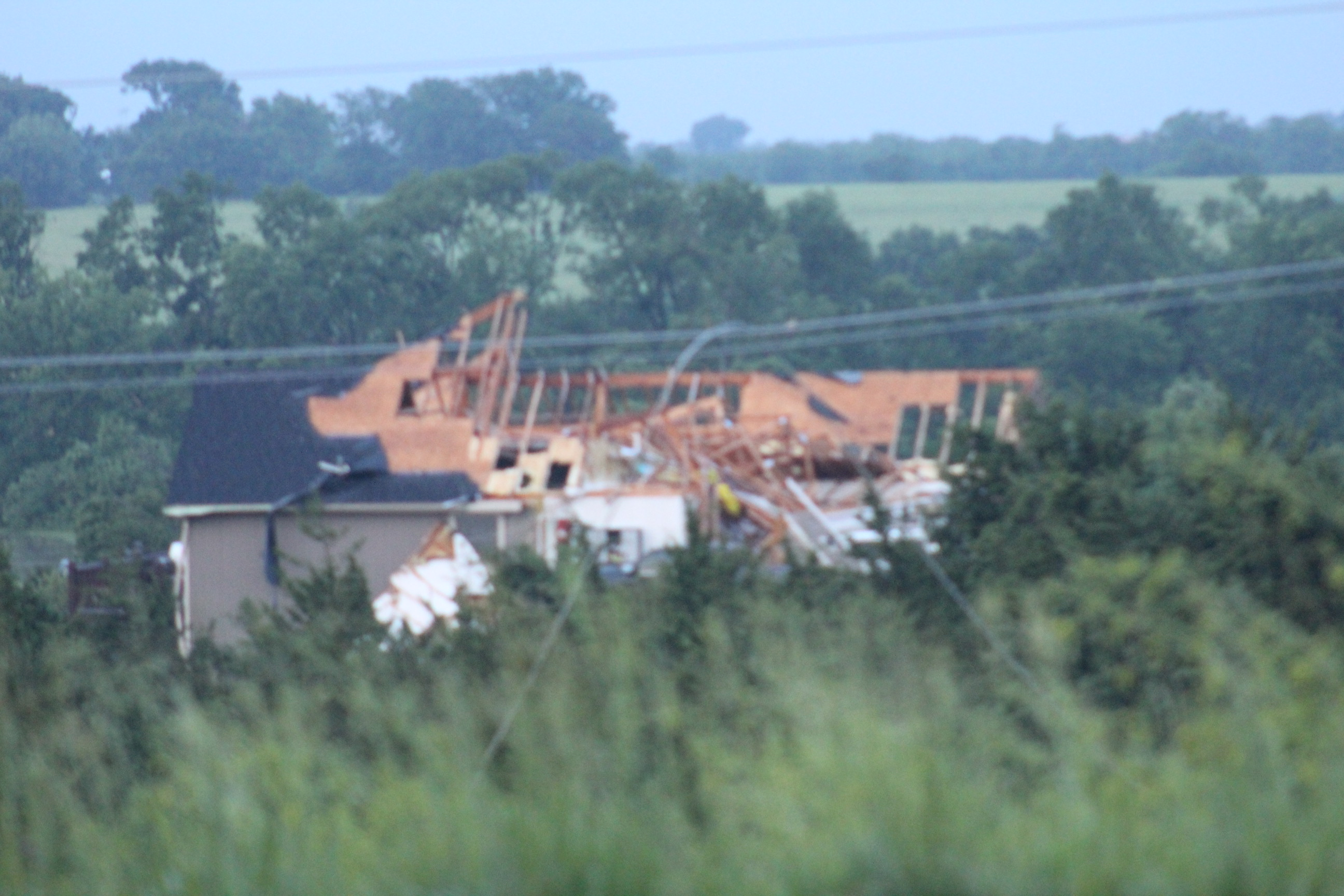 Damaged homes along U.S. Highway 59 south of Lawrence (Photo by J. Schafer)