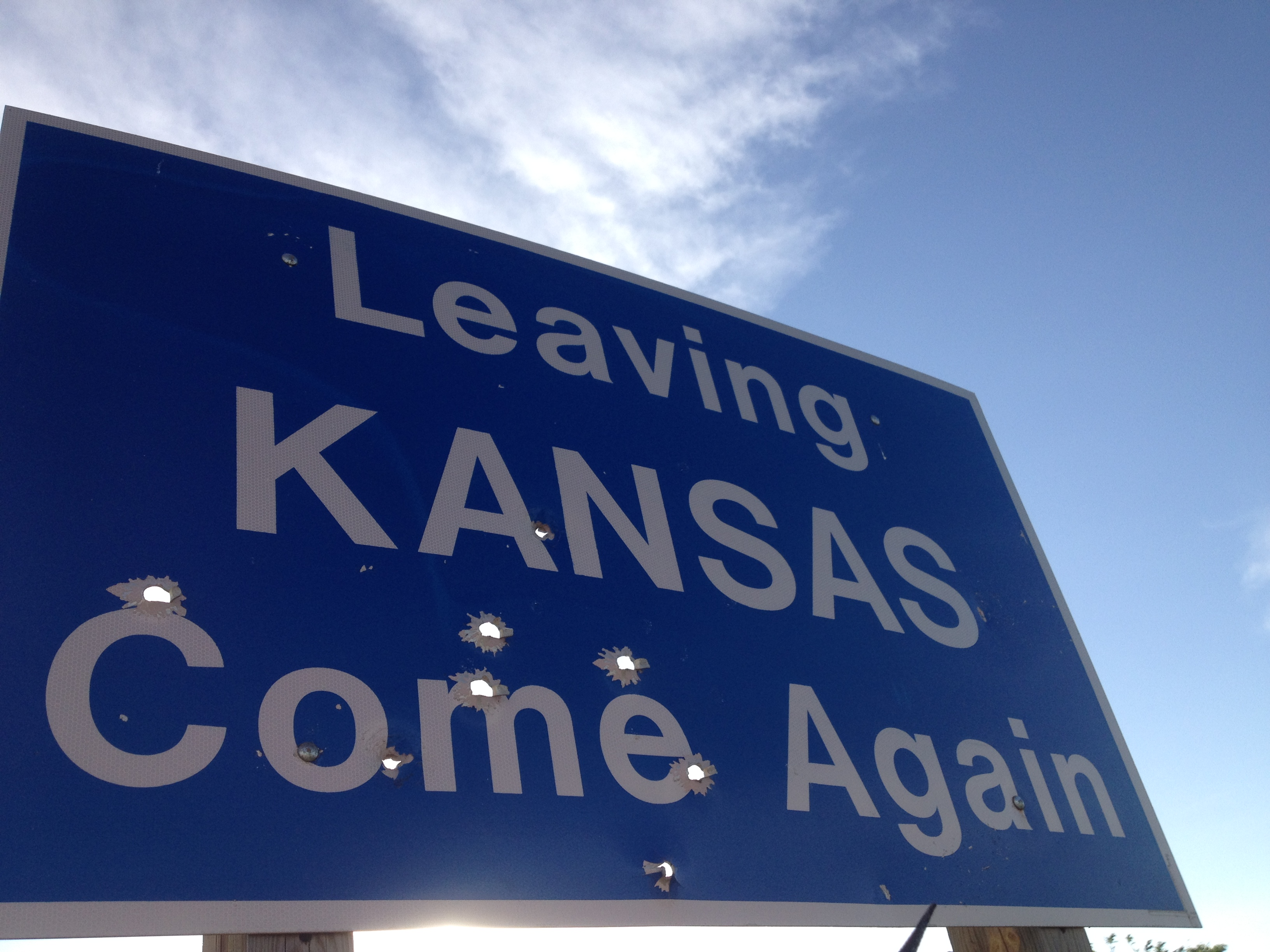 Angry bullet holes? Some Kansas residents are fed up with the way things are going in the Sunflower State. (Photo by J. Schafer)