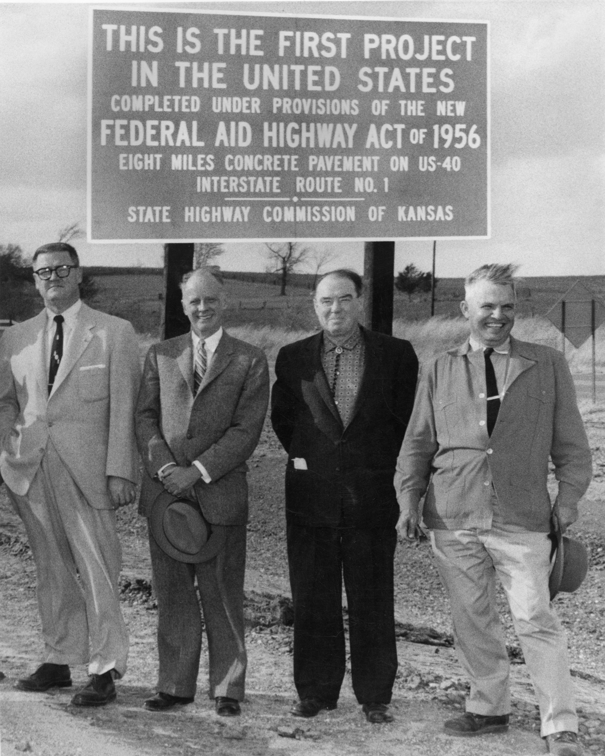 Kansas is the home of the first project completed under the 1956 highway law for an 8 mile section of U.S. 40 (I-70) west of Topeka. Pictured here are four representatives of the engineering contractor and the Kansas highway commission mark the occasion. (photo credit: Kansas Department of Transportation)