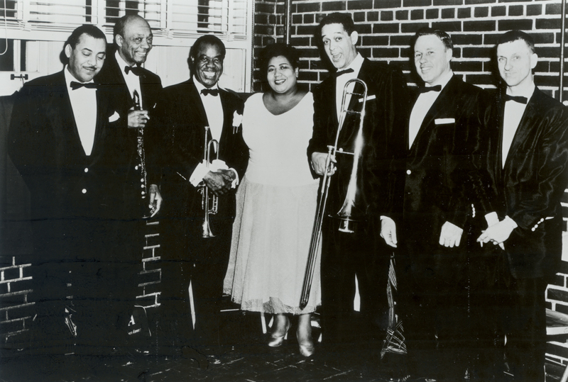 Louis Armstong and members of his 1957 travelling band. (Photo courtesy of the Louis Armstrong House Museum)