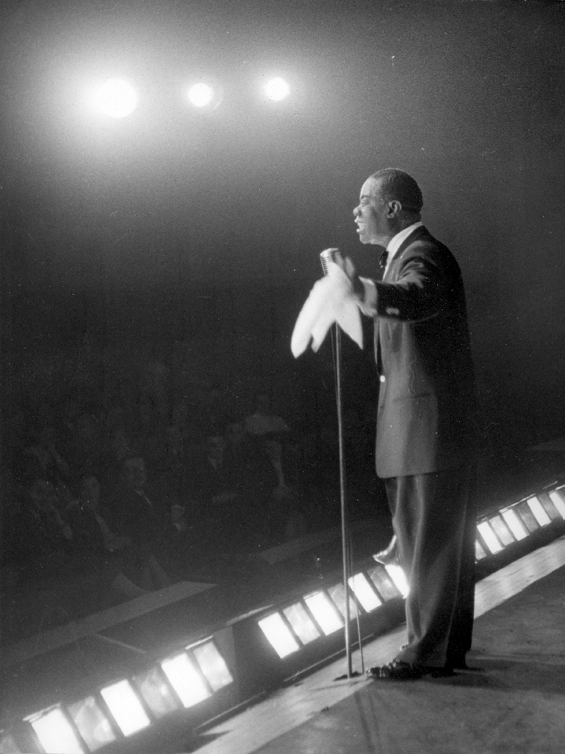 Louis Armstrong in performance.  (Photo courtesy of the Louis Armstrong House Museum)