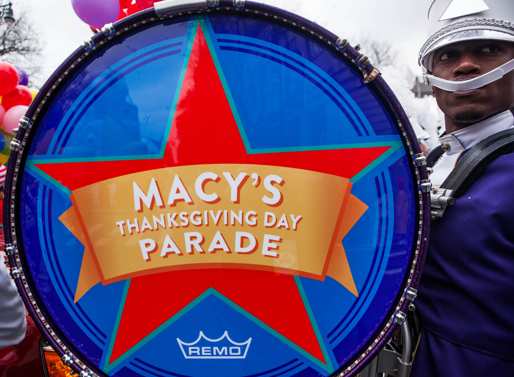 A drummer in a marching band at a Macy's Thanksgiving Day Parade