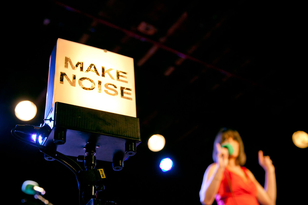 """The """"Make Noise"""" sign onstage at The Bell House, Brooklyn, NY. (Photo by Lam Thuy Vo)"""