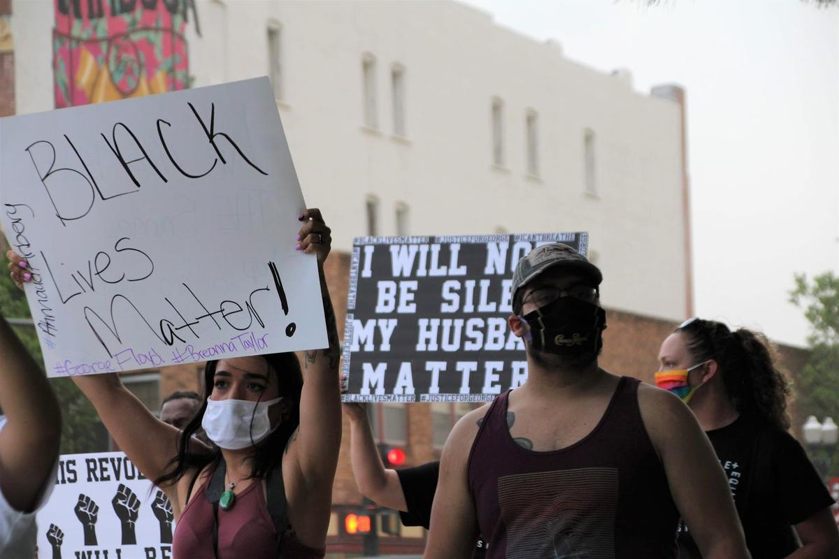 "Many people wore masks as they chanted ""Black Lives Matter"" calling for an end to police violence. (Photo by Corinne Boyer, Kansas News Service)"