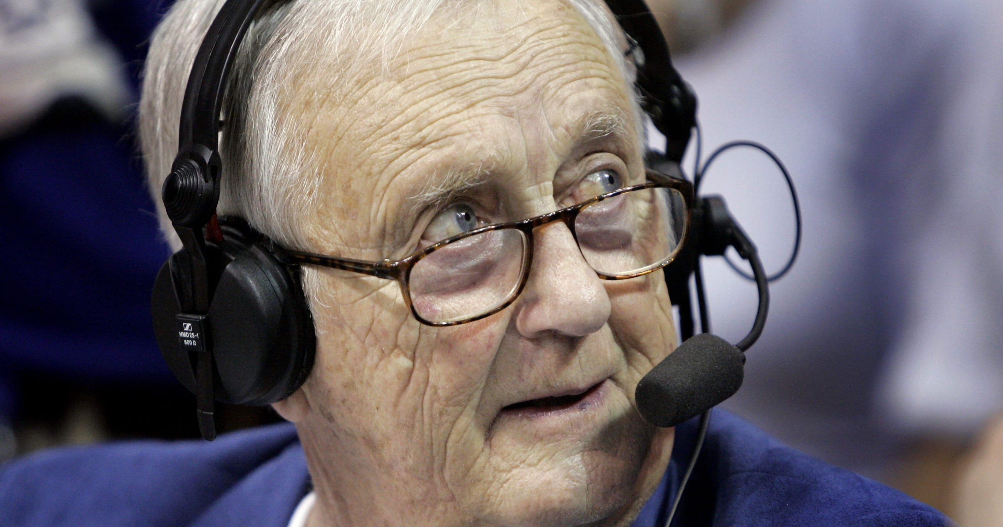 Max behind the mic. Max Falkenstien spent decades broadcasting KU football and basketball games. (Photo by KU Athlectics)