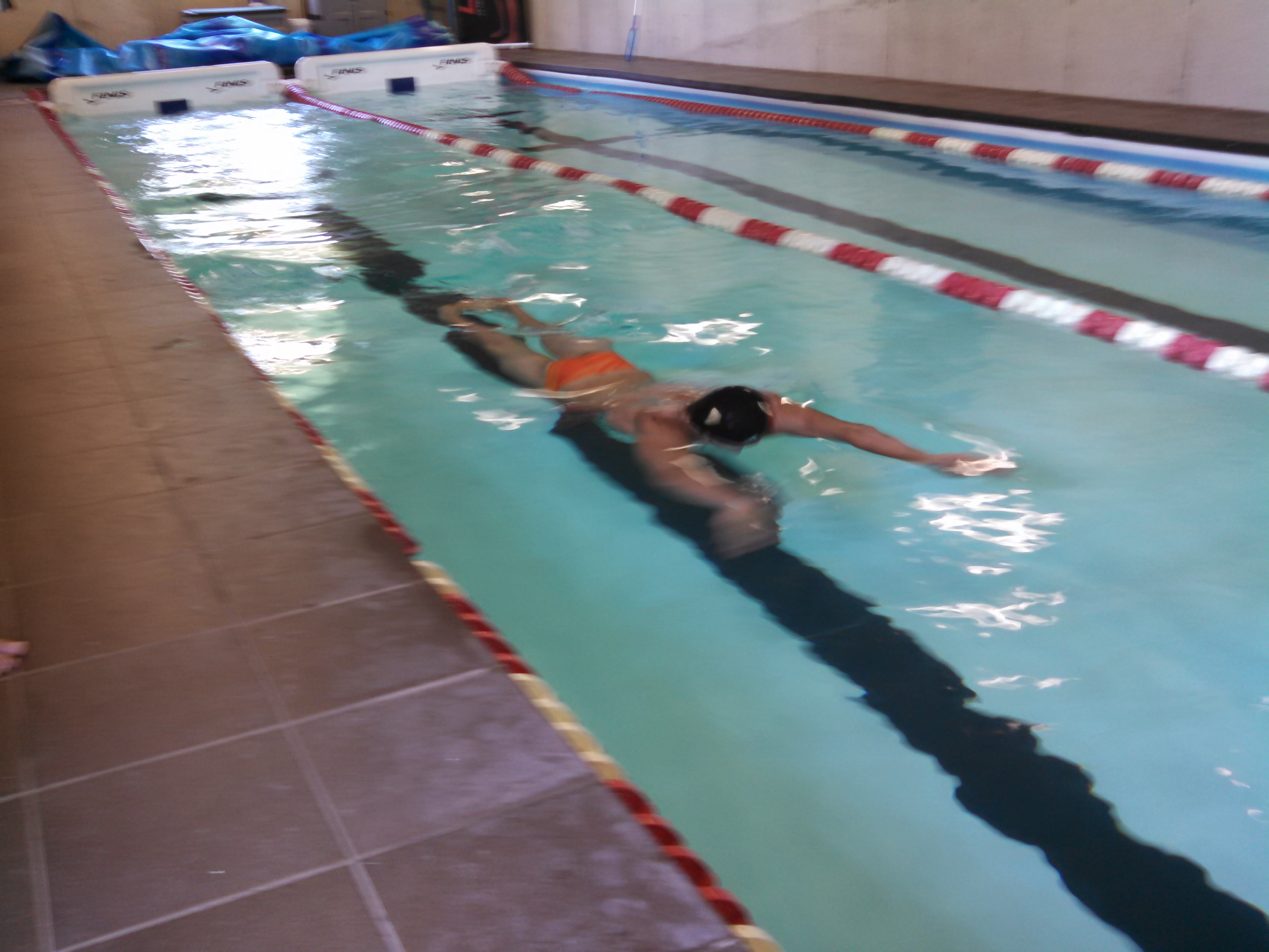 Michael Andrew working out at his family's indoor pool near Lawrence. (Photo by Ian Echlin)