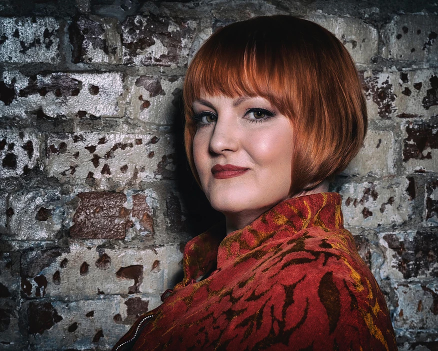 Molly Hammer takes the stage as lead vocalist with her rich, smoky-hued voiced that will transport you back to the jazz clubs of yore.
