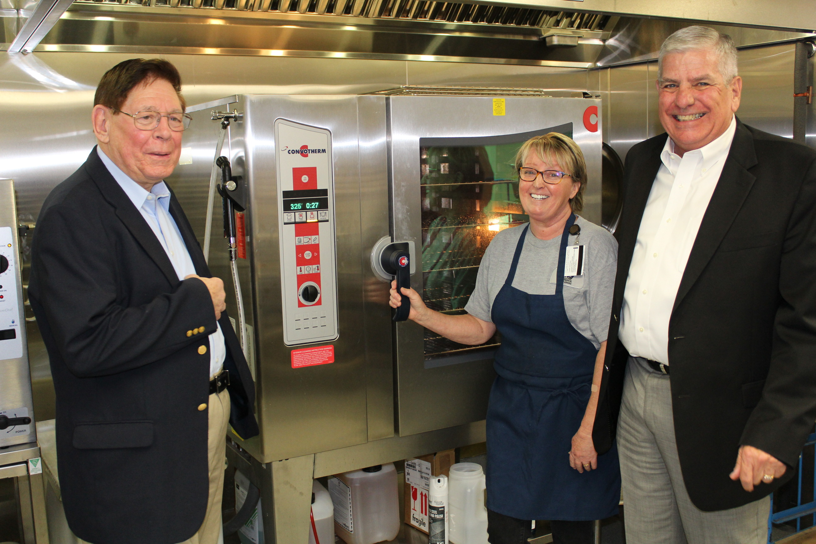Generals Edward Gerhardt and Daryl McCall tour the upgraded kitchen facilities at Hillcrest Elementary. (Photo by J. Schafer)