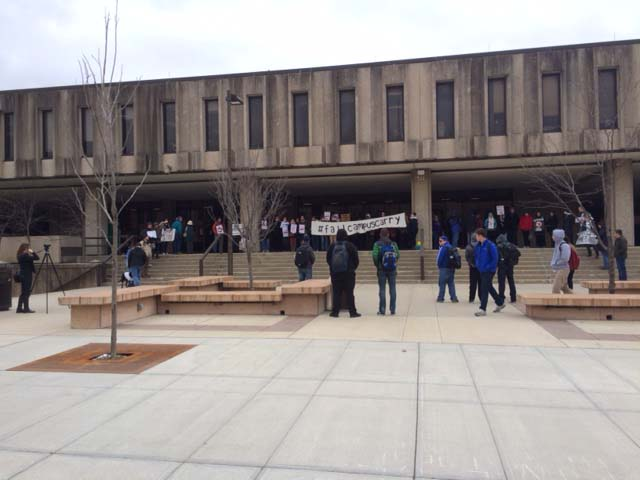 People gathered in front of Wescoe Hall on the KU campus Monday to protest a state law that will allow concealed firearms on campus next year. (Photo by Austin Fitts)