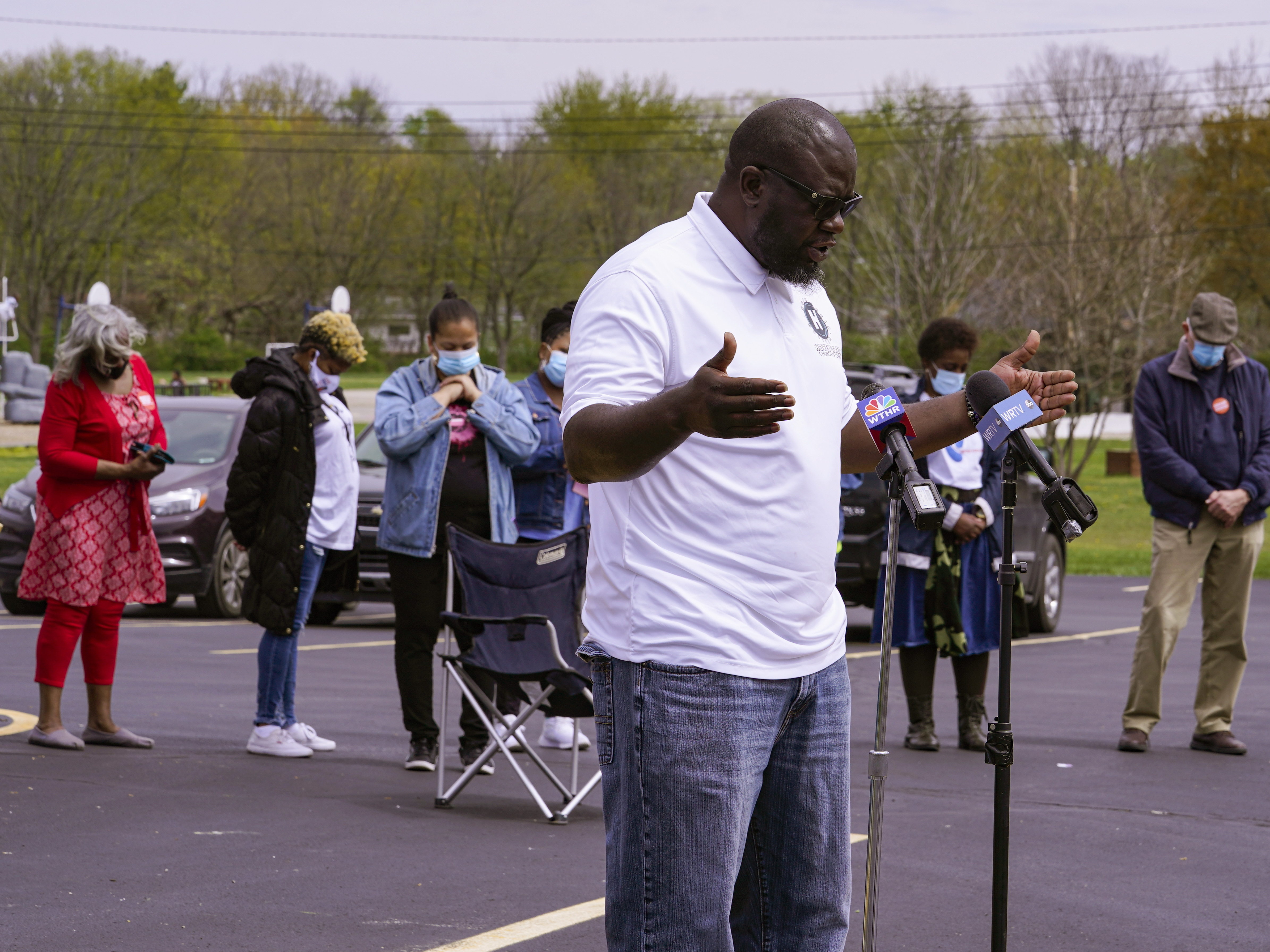 Pastor Denell Howard leads a prayer Saturday at a vigil at Olivet Missionary Baptist Church in Indianapolis for the victims of the shooting Thursday at a FedEx facility.