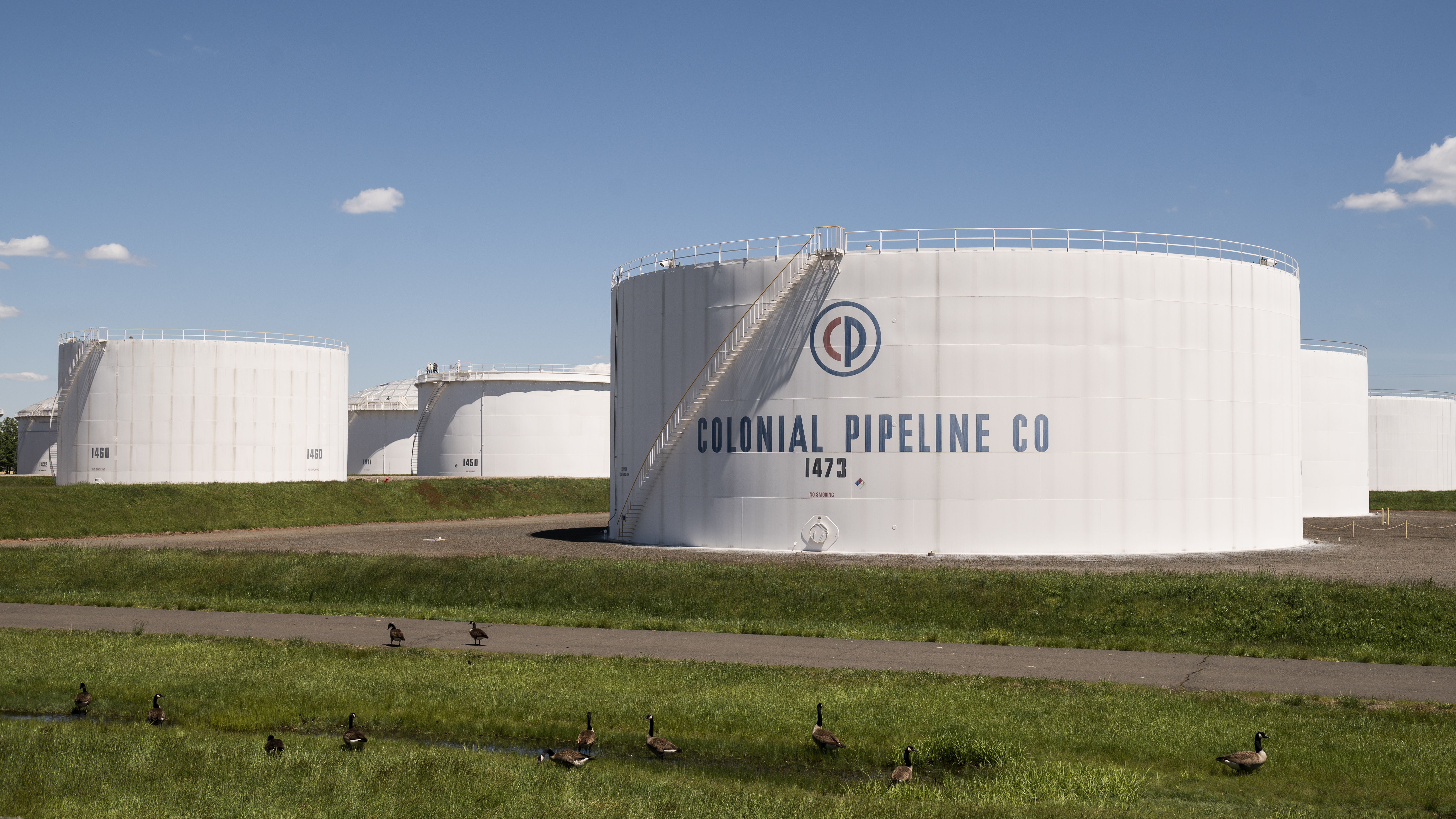 President Biden alluded to the Colonial Pipeline cyberattack in his new executive order. Here, storage tanks at a Colonial Pipeline facility are seen Wednesday in Avenel, N.J.